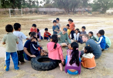 Rick and Anna lead the campers in games during Bible study