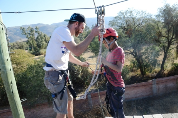 Rogelio listens closely as I instruct him how to rappel correctly
