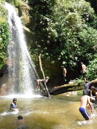 William dives into the pool beneath the falls after a hot hike through the jungle