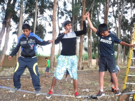 Gary (center) leads his team to success on the ropes course